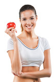 Beautiful fit woman holding an apple