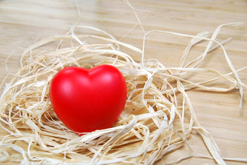 Red heart on raffia ribbons