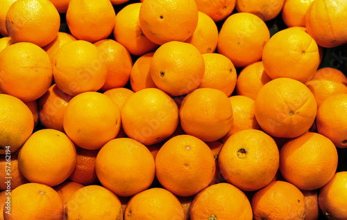 Bunch of fresh mandarin oranges on market