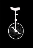 unicycle in silhouette over black
