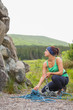 Pretty rock climber looking up at her challenge