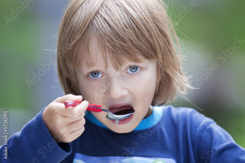 canvas print picture Portrait of a Boy Eating