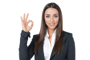 Happy smiling businesswoman with okay gesture