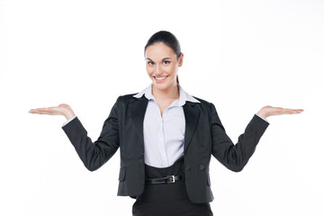 Smiling business woman showing open copy space with both hands.