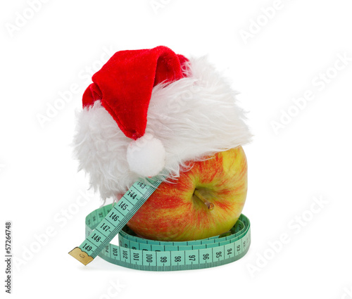 Apple with a measuring meter, in a cap Santa Claus