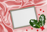 Christmas background with frame for photo and holly leaves
