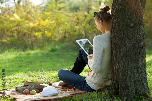 Distance education. Sitting woman using ipad