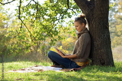 Distance education. Young woman working with ipad.
