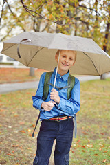 schoolboy with umbrella