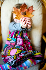 Beautiful european girl  with colorful maple leaf and book