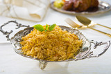chicken biryani served with crockery