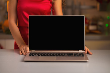 Closeup on laptop blank screen showing by woman in red dress