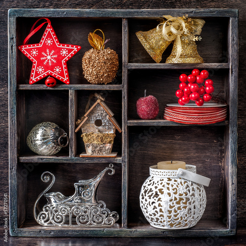 Christmas decorations and toys in a vintage wooden box