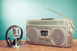 Retro radio and cassette player, headphones, microphone on table