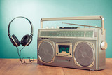 Retro ghetto blaster and headphones conceptual photo