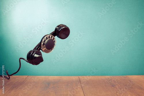 Retro telephone handset with rotary disk concept background