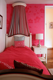 Single bed with red bedding