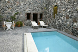 Outdoor stone patio with swimming pool