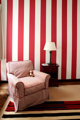 Seating area with red and white wallpaper