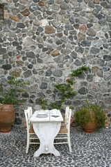 Outdoor patio with stone wall and floor