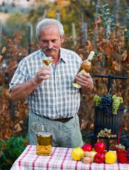 Senior man sampling wine