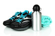 Sports bottle,sneakers and towel isolated on white