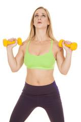 fitness woman green bra weights lifting
