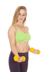 fitness woman green bra weights ready to curl