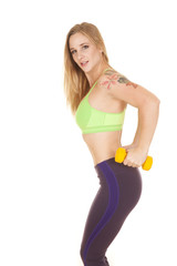 fitness woman green bra weights side