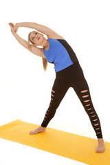 woman fitness holy pants stretch to side.