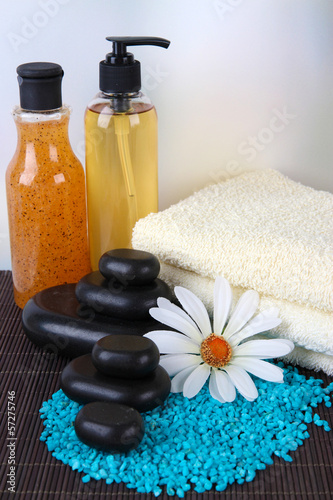 Beautiful spa setting on bamboo mat on bright background