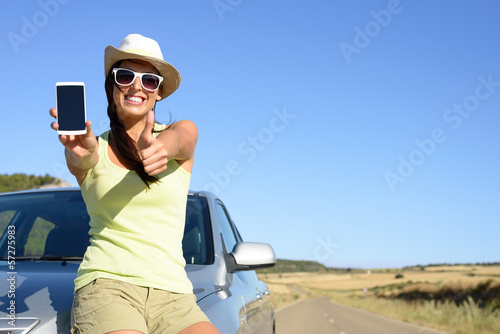 Woman on travel showing phone screen