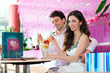 Young couple enjoying their time in ice cream parlor