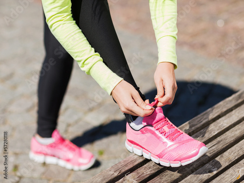 runner woman lacing trainers shoes