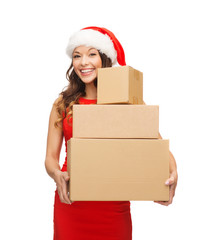 smiling woman in santa helper hat with parcels