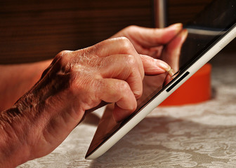pensioner working on a tablet
