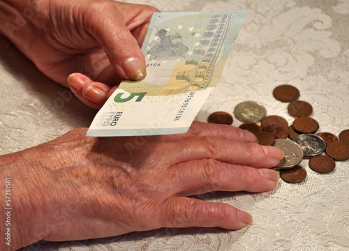 elderly woman and money