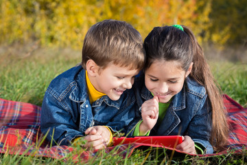 Two kids with tablet PC