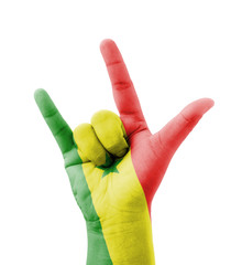 Hand making I love you sign, Senegal flag painted