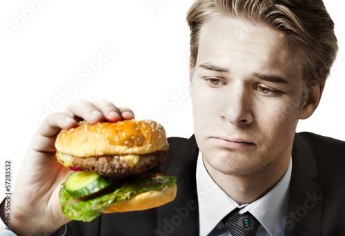 Businessman eating at work