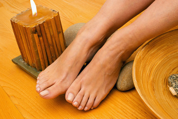 female feet on spa treatment