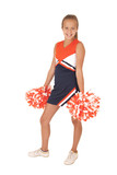 Young high school cheerleader standing with hands at her side  p