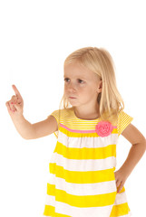 Young female child with hand on hip pointing her finger in a sco