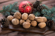 Walnuts, fir-tree branches and xmas ball, studio shot