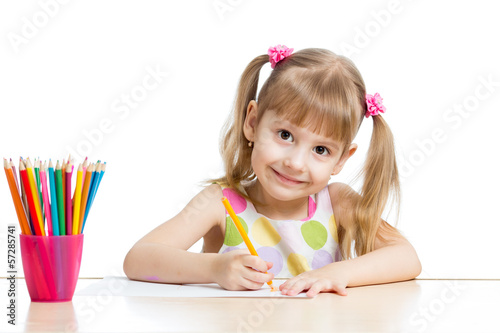 child girl drawing with colourful pencils