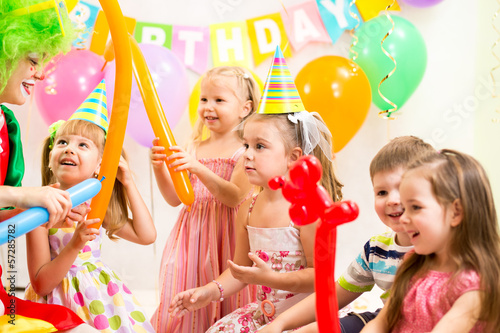 kids group and clown on birthday party