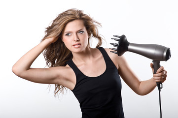 Brunette woman blow-drying long hair