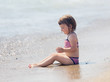 girl siting on sand beach