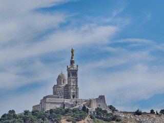 Notre-Dame de la Garde (literally Our Lady of the Guard), is a b