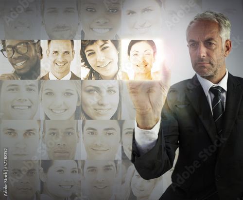 Stern businessman choosing future employees